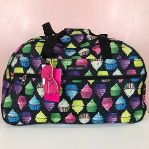 Betsey Johnson cupcake wheeled duffel